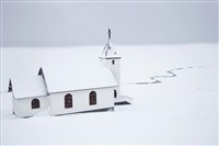 white church on white snow by christophe jacrot