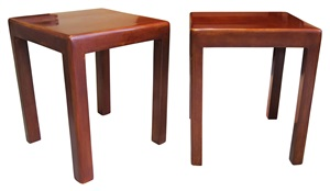 pair of red lacquer side tables by jean dunand