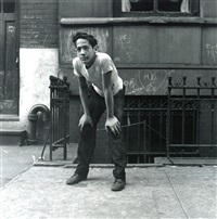 boy playing punchball, new york city by jerome liebling
