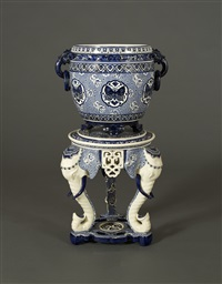 a spectacular pair of minton majolica jardinieres on elephant-form tribod pedestals, with decoration by christopher dresser