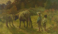two boys with cows