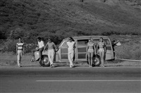 makaha hawaii (people by the car) by leroy grannis