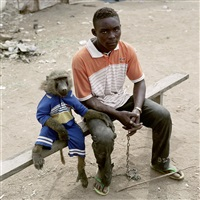 dayaba usman with the monkey clear, nigeria (from the series the hyena and other men) by pieter hugo