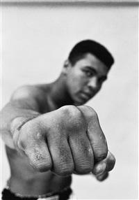 MUHAMMAD ALI SHOWING OFF HIS RIGHT FIST,..., 1966