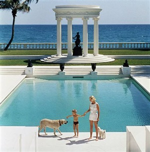 the good life, 1955: c.z. guest and her son alexander and dog at the pool at their home villa artemis in palm beach by slim aarons