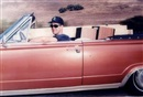 Andrew Bush, Untitled (Man in pink convertible)