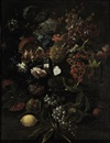 Circle Of Mario Nuzzi, Various flowers in a glass vase with blue grapes, peaches and a lemon, all on a ledge