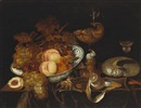 Circle Of Bartholomeus Assteyn, A still life of fruit in a blue and white bowl, a ewer, a goblet, a partially-peeled lemon and a nautilus shell, all resting on a partially draped table