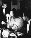 Paul Himmel, Mary Jane and Ed Russell dining (Fashion study)