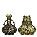 Amphora Werke Reissner, Four-handled vase with reticulated roundels, and squat vase with holly decoration (2 works)