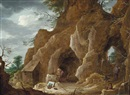 Attributed To David Teniers the Younger, A rocky landscape with Saint Jerome praying