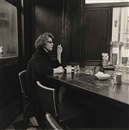 Diane Arbus, Woman at a Counter Smoking, N.Y.C
