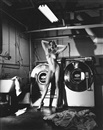 Helmut Newton, Domestic Nude III, in the laundry room, Château Marmont, Hollywood