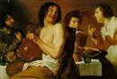 Figures eating and drinking around a table by Theodor Rombouts