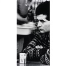 Situation (Man with cigarette pack on table) by Sam Samore