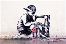Slave Labor (Bunting Boy), London by  Banksy