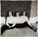 Triplets in their bedroom, N.J by Diane Arbus