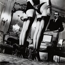 Two pairs of legs in black stockings, Paris (from Private Property Suite III) by Helmut Newton