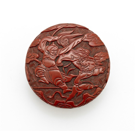 A rare tihong carved cinnabar lacquer box and cover