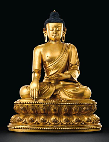 An outstanding and highly important massive gilt-bronze figure of a seated Shakyamuni Buddha