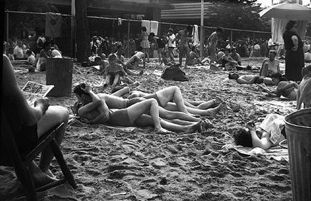 Coney Island, New York (Couple Kissing at Beach) by Vivian Maier