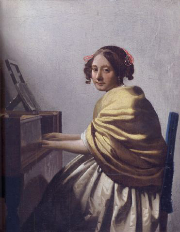 A Young Woman Seated at the Virginal by Johannes Vermeer