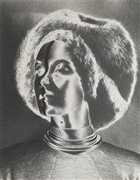 solarised hat & profile, new york by erwin blumenfeld