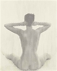seated nude behind perforated screen, new york by erwin blumenfeld
