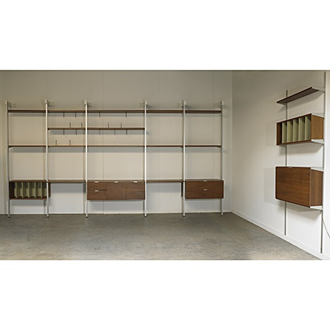 Two Storage Units Composed Of One Floor To Ceiling Five Bay And
